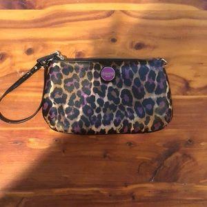 Coach Ocelot leopard/purple print wristlet